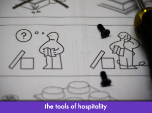 "Ikea instructions: puzzled Ikea man makes phone call for help; slide text: ""the tools of hospitality"""