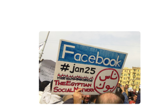"Sign with ""Facebook"" and Arabic text"