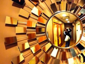Person taking selfie in a mirror made of fragments